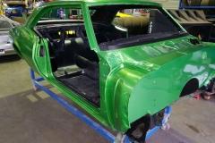 paint-panel-green-sedan-body-workshop